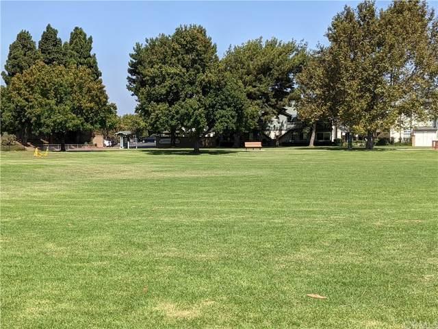 18292 Parkview Lane #201, Huntington Beach, CA 92648 (#OC21206946) :: The Miller Group