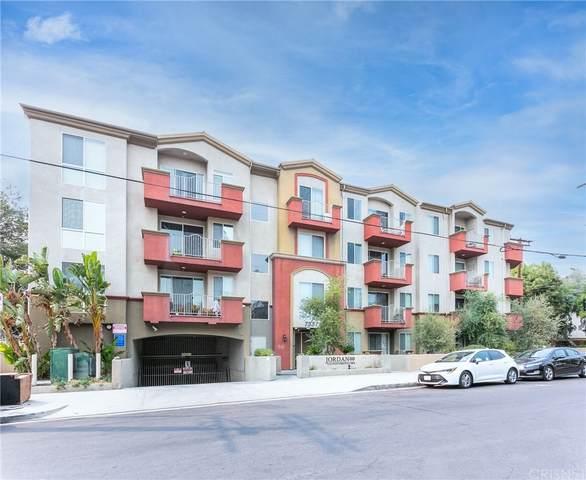 7551 Jordan Avenue #102, Canoga Park, CA 91303 (#SR21212067) :: Twiss Realty