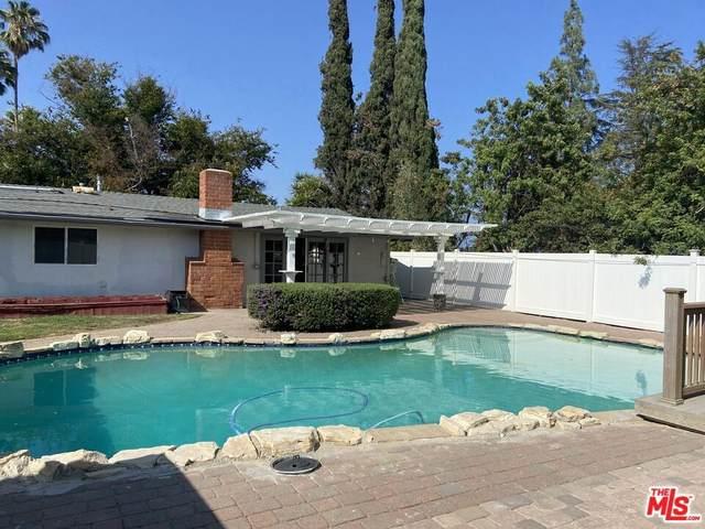 20502 Oxnard Street, Woodland Hills, CA 91367 (#21787984) :: Corcoran Global Living