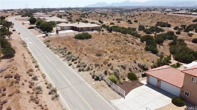 8400 Joshua Road, Oak Hills, CA 92344 (#CV21213927) :: Zember Realty Group