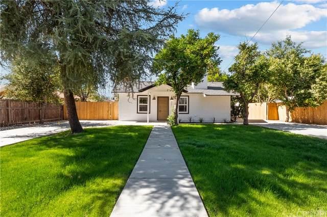 9403 Noble Avenue, North Hills, CA 91343 (#SR21226203) :: Zutila, Inc.