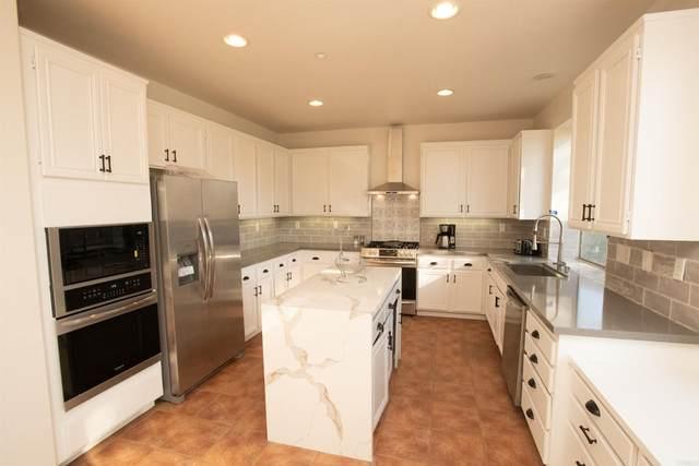 1567 Cypress Creek Court, Vista, CA 92084 (#NDP2111760) :: Swack Real Estate Group | Keller Williams Realty Central Coast