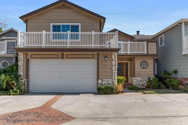 18833 Hatteras Street #109, Tarzana, CA 91356 (#SR21227098) :: Blake Cory Home Selling Team