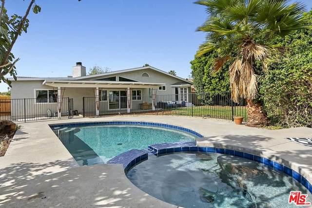 8460 Hatillo Avenue, Winnetka, CA 91306 (#21796834) :: Latrice Deluna Homes