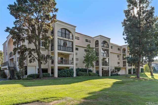 5519 Paseo Del Lago E 2D, Laguna Woods, CA 92637 (#OC21233576) :: Mark Nazzal Real Estate Group
