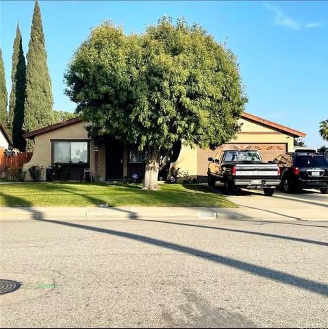11735 Yorba Avenue, Chino, CA 91710 (#PW21234449) :: Compass
