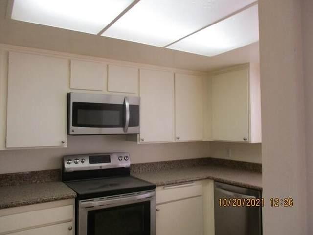 1204 Antigua Circle, Palm Springs, CA 92264 (#219069400DA) :: Necol Realty Group