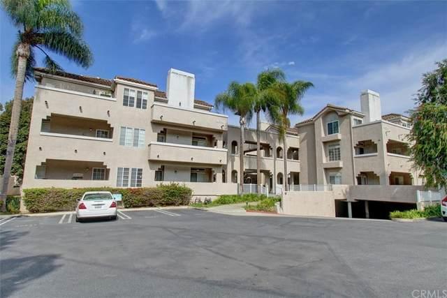 4581 Warner Ave. #103 Avenue #103, Huntington Beach, CA 92649 (#OC21228383) :: Blake Cory Home Selling Team