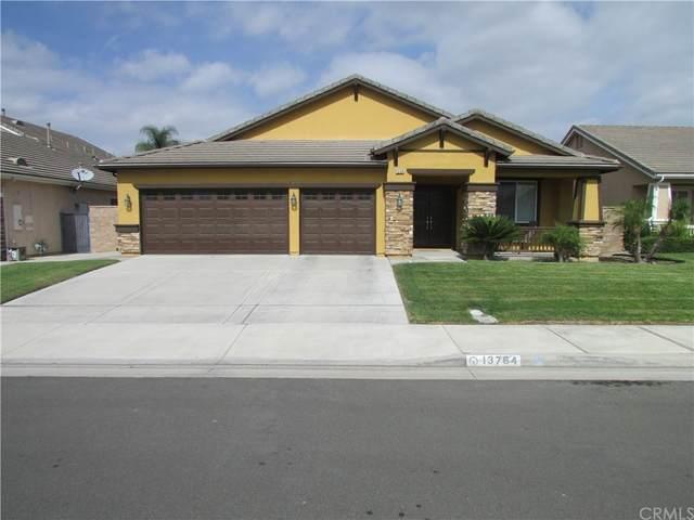13764 Woodlands Street, Eastvale, CA 92880 (#IG21235678) :: Rogers Realty Group/Berkshire Hathaway HomeServices California Properties
