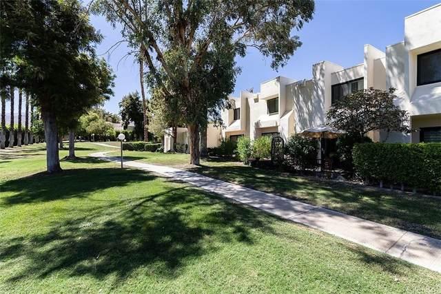 48792 Desert Flower, Palm Desert, CA 92260 (#OC21206432) :: Swack Real Estate Group   Keller Williams Realty Central Coast