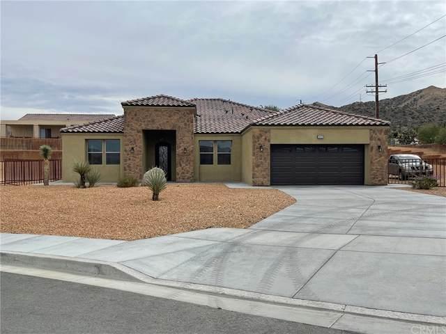 56925 Hidden Gold Court, Yucca Valley, CA 92284 (#JT21220624) :: Compass