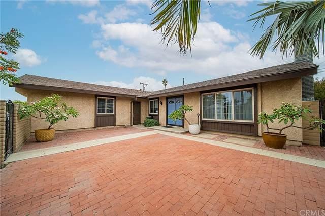 6301 Balmoral Drive, Huntington Beach, CA 92647 (#OC21220627) :: The M&M Team Realty