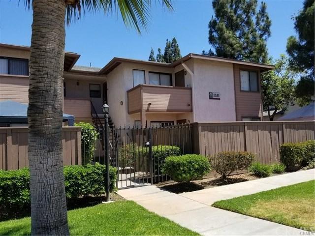 1311 Massachusetts Avenue #203, Riverside, CA 92507 (#AR17228549) :: Carrington Real Estate Services