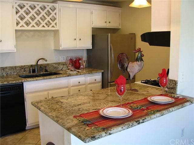6600 Warner Avenue #101, Huntington Beach, CA 92647 (#PW18062161) :: DiGonzini Real Estate Group