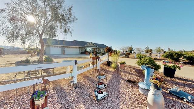 6880 Aster Road, Oak Hills, CA 92344 (#EV18091147) :: The Ashley Cooper Team