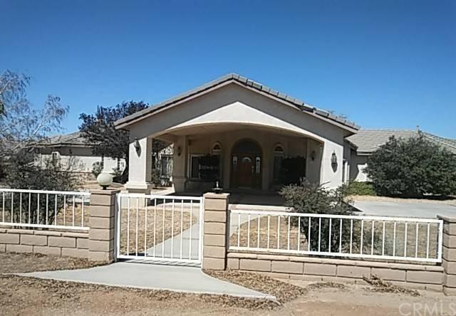 9768 Wisteria Court, Oak Hills, CA 92344 (#IV18224899) :: The Ashley Cooper Team