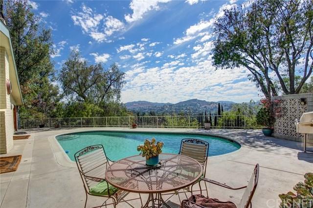 4725 Burgundy Road, Woodland Hills, CA 91364 (#SR18229215) :: Barnett Renderos