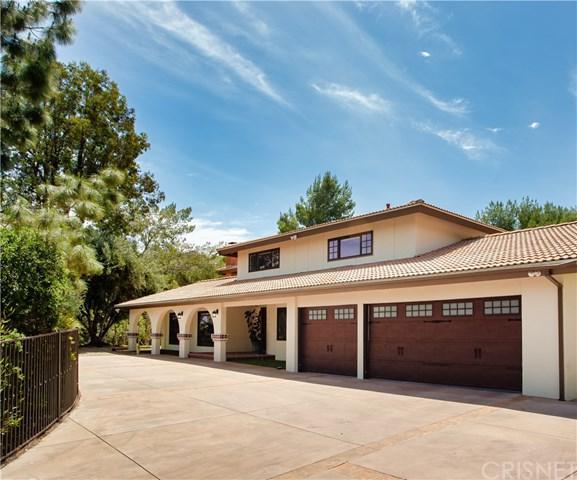 20254 Wells Drive, Woodland Hills, CA 91364 (#SR19117752) :: Kim Meeker Realty Group