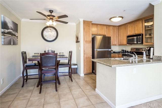 1023 Vista Del Cerro Drive #303, Corona, CA 92879 (#IG19167581) :: Heller The Home Seller