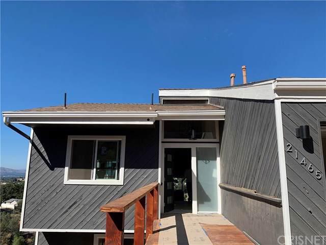 21465 Iglesia Drive, Woodland Hills, CA 91364 (#SR19174062) :: Fred Sed Group