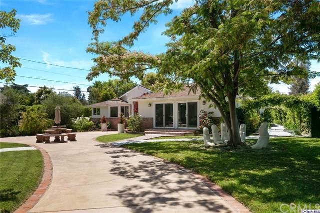 23202 Oxnard Street, Woodland Hills, CA 91367 (#319002986) :: The Brad Korb Real Estate Group