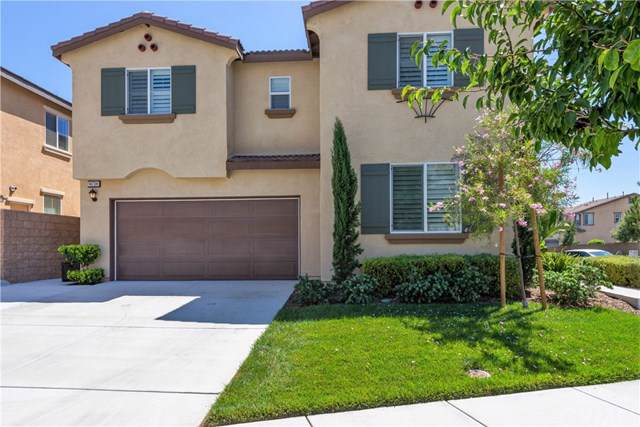 14734 Symphony Drive, Eastvale, CA 92880 (#IG19196889) :: The Danae Aballi Team