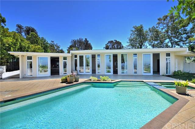 8057 Mulholland Drive, Los Angeles (City), CA 90046 (#SR19197393) :: California Realty Experts