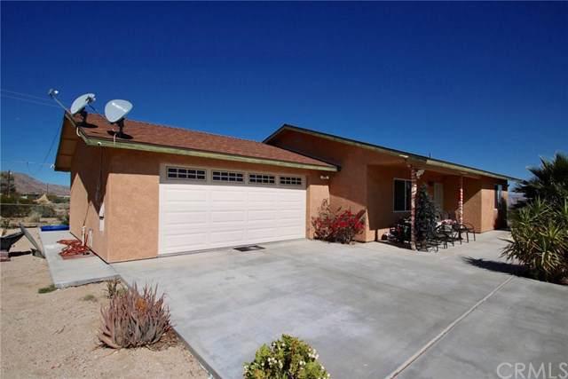 7504 Sherman Hoyt Avenue, 29 Palms, CA 92277 (#JT19198908) :: The Laffins Real Estate Team