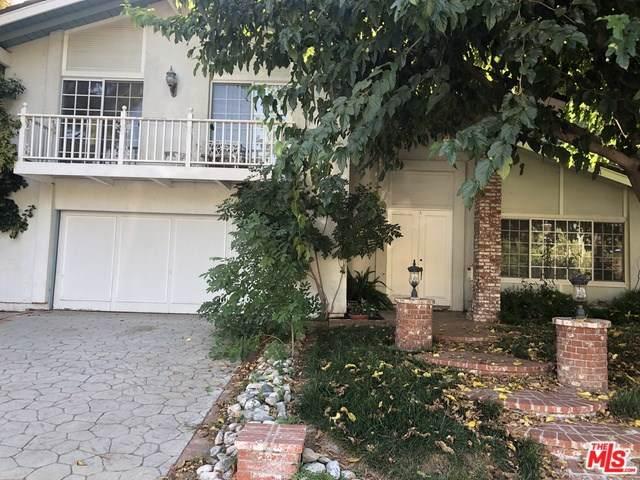 25402 Avenida Cappela, Valencia, CA 91355 (#19507320) :: J1 Realty Group