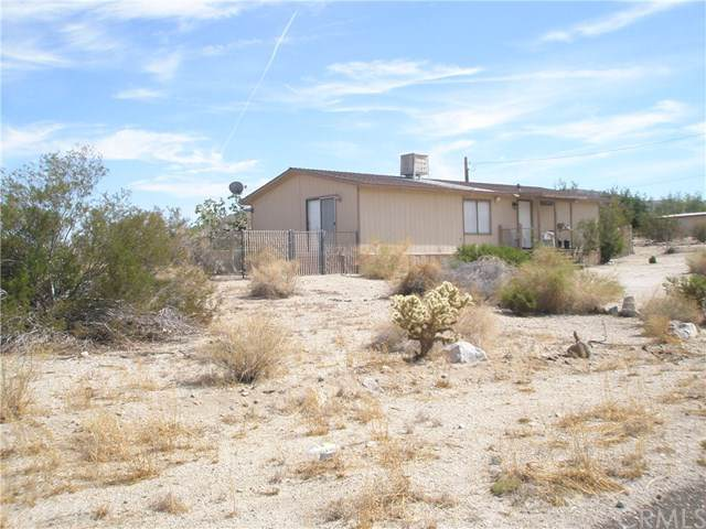 7677 Bedouin Avenue, 29 Palms, CA 92277 (#JT19220615) :: Abola Real Estate Group