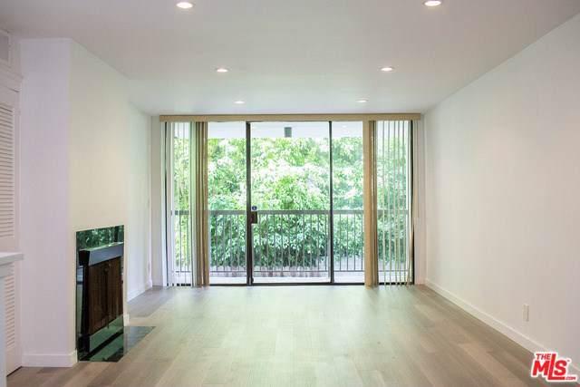 911 N Kings Road #113, West Hollywood, CA 90069 (#19511306) :: Powerhouse Real Estate