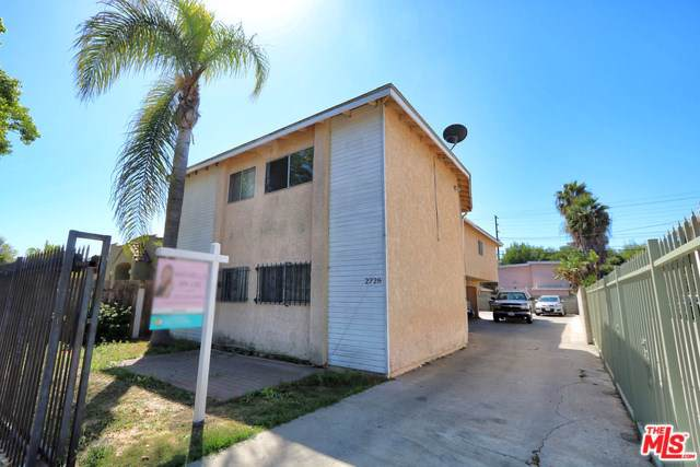 2728 Exposition Place, Los Angeles (City), CA 90018 (#19511602) :: The Costantino Group | Cal American Homes and Realty