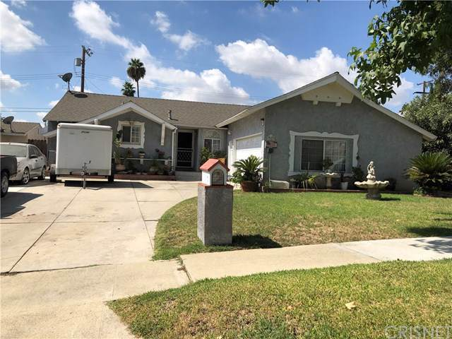 12869 Adelphia Avenue, San Fernando, CA 91340 (#SR19224637) :: Bob Kelly Team