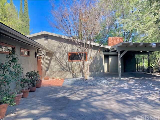 22421 Mulholland Drive, Woodland Hills, CA 91364 (#SR19245619) :: The Parsons Team