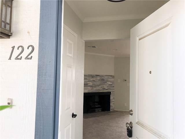 18550 Hatteras Street #122, Tarzana, CA 91356 (#CV19243540) :: The Miller Group