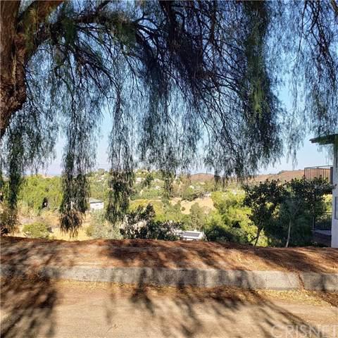 21487 Iglesia Drive, Woodland Hills, CA 91364 (#SR19245976) :: The Parsons Team