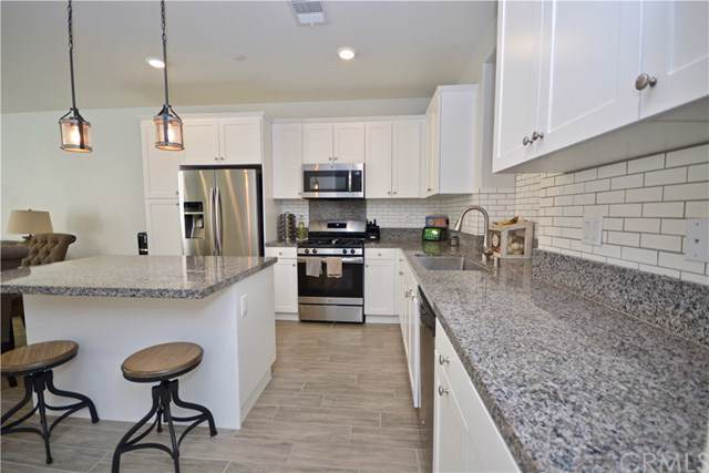 13969 Blossom Way, Eastvale, CA 92880 (#SW19247380) :: Mainstreet Realtors®