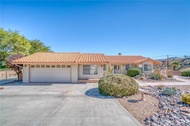7591 Fairway Drive, Yucca Valley, CA 92284 (#JT19255840) :: J1 Realty Group