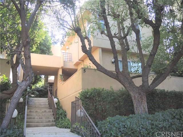 18730 Hatteras Street #5, Tarzana, CA 91356 (#SR19252198) :: J1 Realty Group
