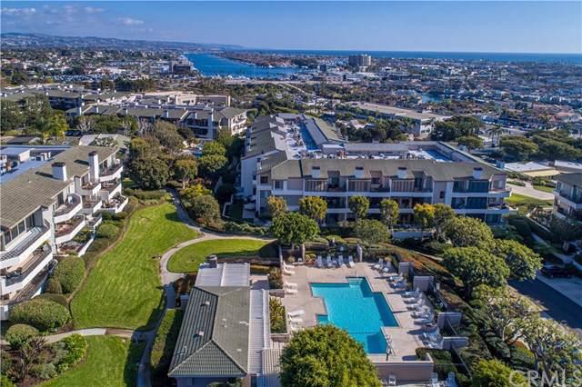 240 Nice Lane #310, Newport Beach, CA 92663 (#PW20014810) :: The Laffins Real Estate Team