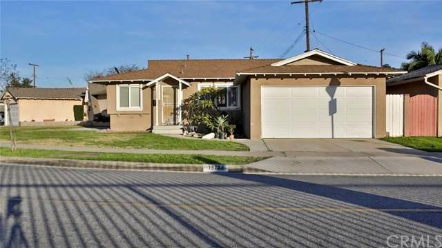 15724 Hayter Avenue, Paramount, CA 90723 (#TR20027859) :: Crudo & Associates