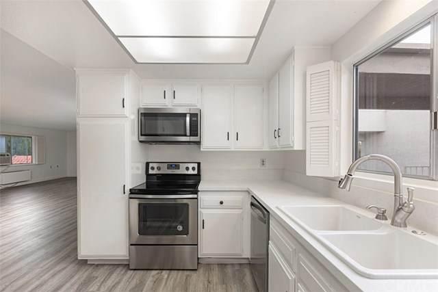 2401 Via Mariposa W 3H, Laguna Woods, CA 92637 (#OC20031965) :: Z Team OC Real Estate
