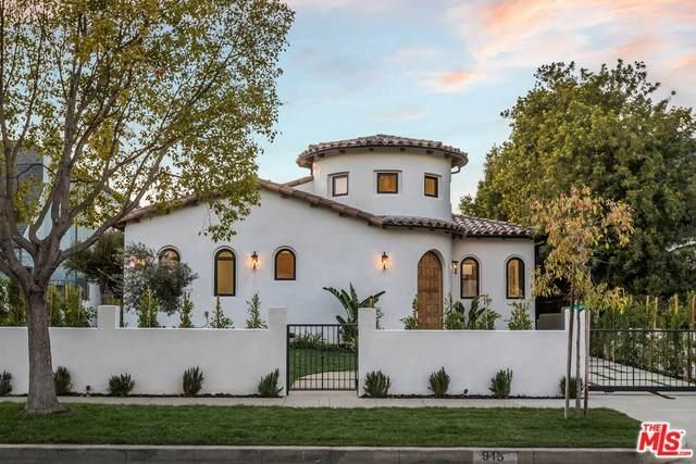 915 S Muirfield Road, Los Angeles (City), CA 90019 (#20554938) :: Twiss Realty