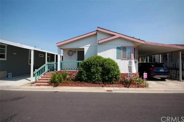 21851 Newland Street #262, Huntington Beach, CA 92648 (#OC20035076) :: Compass Realty