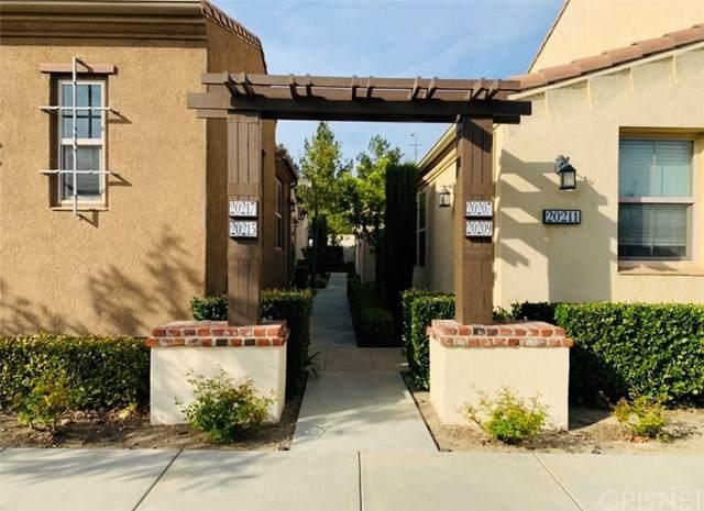 20209 Livorno Way, Porter Ranch, CA 91326 (#SR20054587) :: RE/MAX Empire Properties