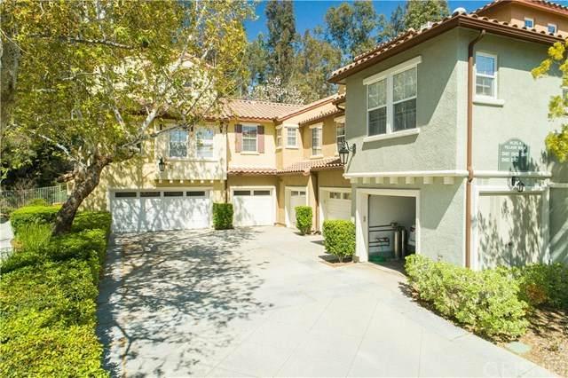 23427 Abbey Glen Place, Valencia, CA 91354 (#SR20064879) :: Berkshire Hathaway HomeServices California Properties