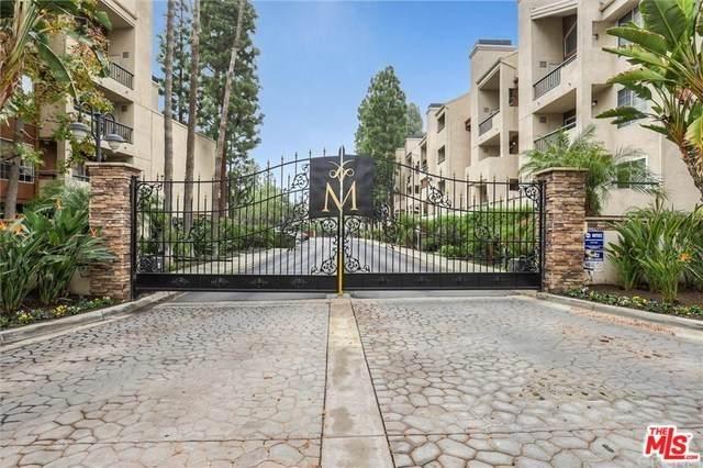 21520 Burbank #318, Woodland Hills, CA 91367 (#20567902) :: Cal American Realty