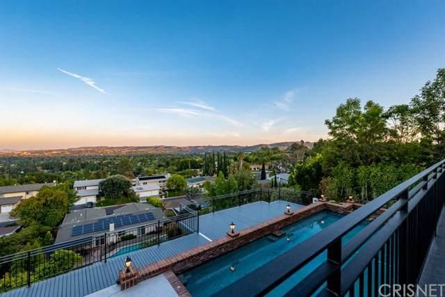 5952 Woodland View Drive, Woodland Hills, CA 91367 (#SR20012834) :: Crudo & Associates