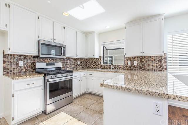 8338 Woodley Place #36, North Hills, CA 91343 (#SR20094810) :: The Costantino Group | Cal American Homes and Realty