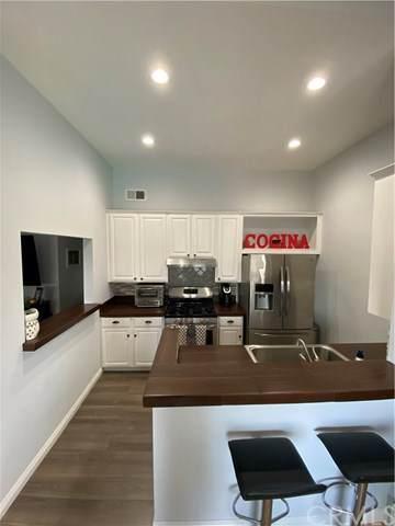 15213 Santa Gertrudes Avenue W202, La Mirada, CA 90638 (#TR20103356) :: Mark Nazzal Real Estate Group